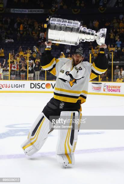 Matt Murray of the Pittsburgh Penguins celebrates with the Stanley Cup Trophy after defeating the Nashville Predators 20 to win the 2017 NHL Stanley...