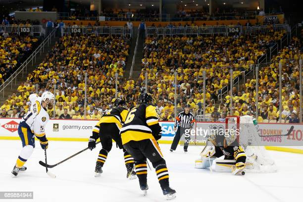 Matt Murray of the Pittsburgh Penguins defends against Austin Watson of the Nashville Predators in Game One of the 2017 NHL Stanley Cup Final at PPG...