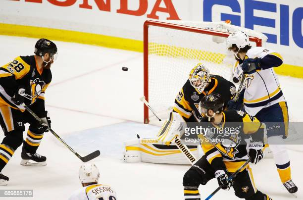 Matt Murray of the Pittsburgh Penguins defends against Colton Sissons of the Nashville Predators in Game One of the 2017 NHL Stanley Cup Final at PPG...