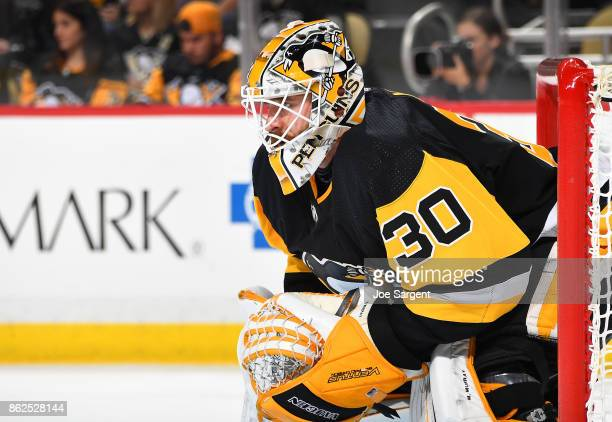 Matt Murray of the Pittsburgh Penguins defends the net against the Florida Panthers at PPG Paints Arena on October 14 2017 in Pittsburgh Pennsylvania