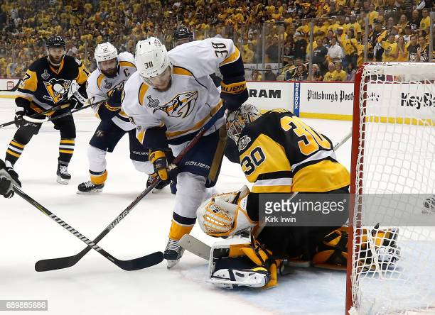 Matt Murray of the Pittsburgh Penguins defends the net against Viktor Arvidsson of the Nashville Predators in Game One of the 2017 NHL Stanley Cup...