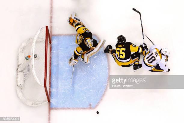 Matt Murray of the Pittsburgh Penguins dives to stop the puck against James Neal of the Nashville Predators as Ron Hainsey defends during the first...