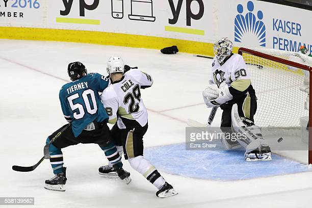 Matt Murray of the Pittsburgh Penguins gives up the game winning goal to Joonas Donskoi of the San Jose Sharks in front of Chris Tierney and Ian Cole...
