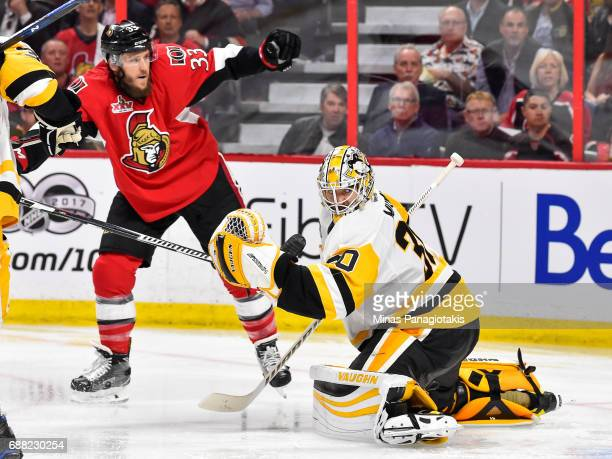 Matt Murray of the Pittsburgh Penguins looks behind him as Fredrik Claesson of the Ottawa Senators stands nearby in Game Six of the Eastern...