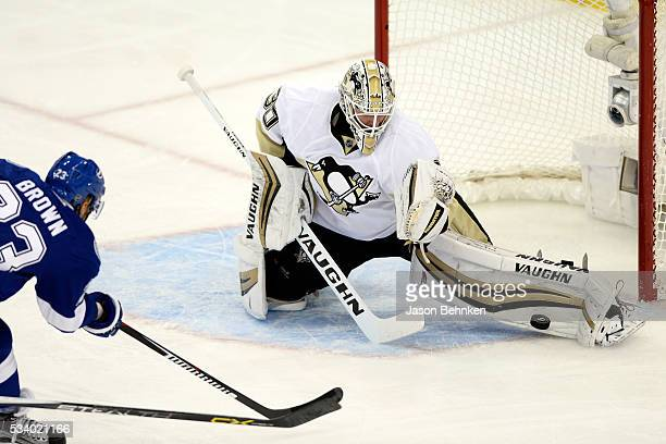 Matt Murray of the Pittsburgh Penguins makes a kick save against JT Brown of the Tampa Bay Lightning during the first period in Game Six of the...
