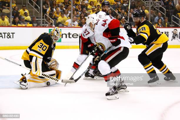 Matt Murray of the Pittsburgh Penguins makes a save against JeanGabriel Pageau of the Ottawa Senators in Game Five of the Eastern Conference Final...