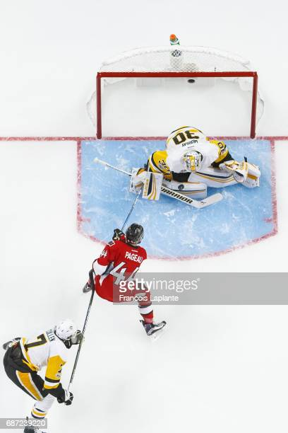 Matt Murray of the Pittsburgh Penguins makes a save as Olli Maatta defends against JeanGabriel Pageau of the Ottawa Senators in Game Four of the...