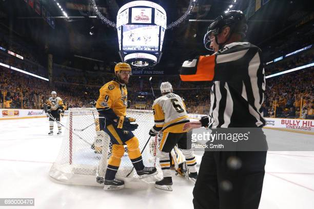 Matt Murray of the Pittsburgh Penguins makes a save as Trevor Daley defends Filip Forsberg of the Nashville Predators during the second period in...
