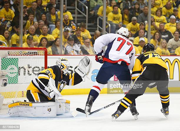 Matt Murray of the Pittsburgh Penguins makes a save on TJ Oshie of the Washington Capitals in Game Three of the Eastern Conference Second Round...