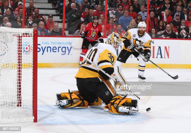 Matt Murray of the Pittsburgh Penguins makes a save with teammate Ian Cole and Erik Karlsson of the Ottawa Senators looking on in Game Six of the...