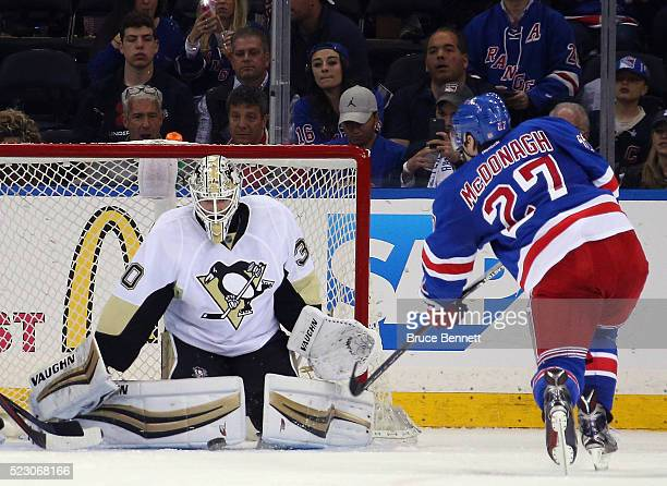 Matt Murray of the Pittsburgh Penguins makes the third period stop on Ryan McDonagh of the New York Rangers in Game Four of the Eastern Conference...