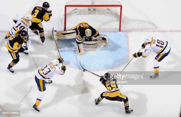 Matt Murray of the Pittsburgh Penguins protects the net against James Neal and Colin Wilson of the Nashville Predators at PPG Paints Arena on January...