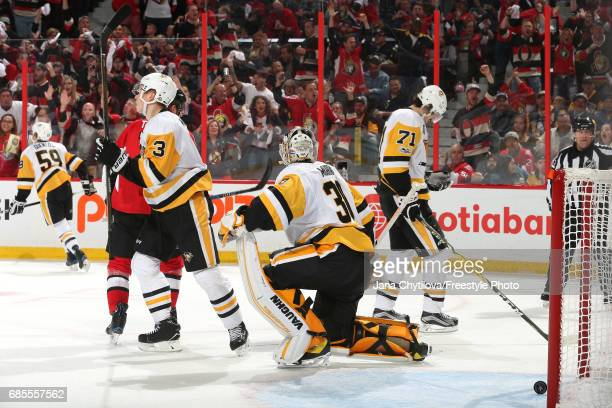 Matt Murray of the Pittsburgh Penguins reacts after giving up a goal to Clarke MacArthur of the Ottawa Senators during the second period in Game Four...