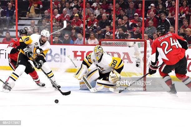 Matt Murray of the Pittsburgh Penguins tends goal against Viktor Stalberg of the Ottawa Senators during the third period in Game Three of the Eastern...