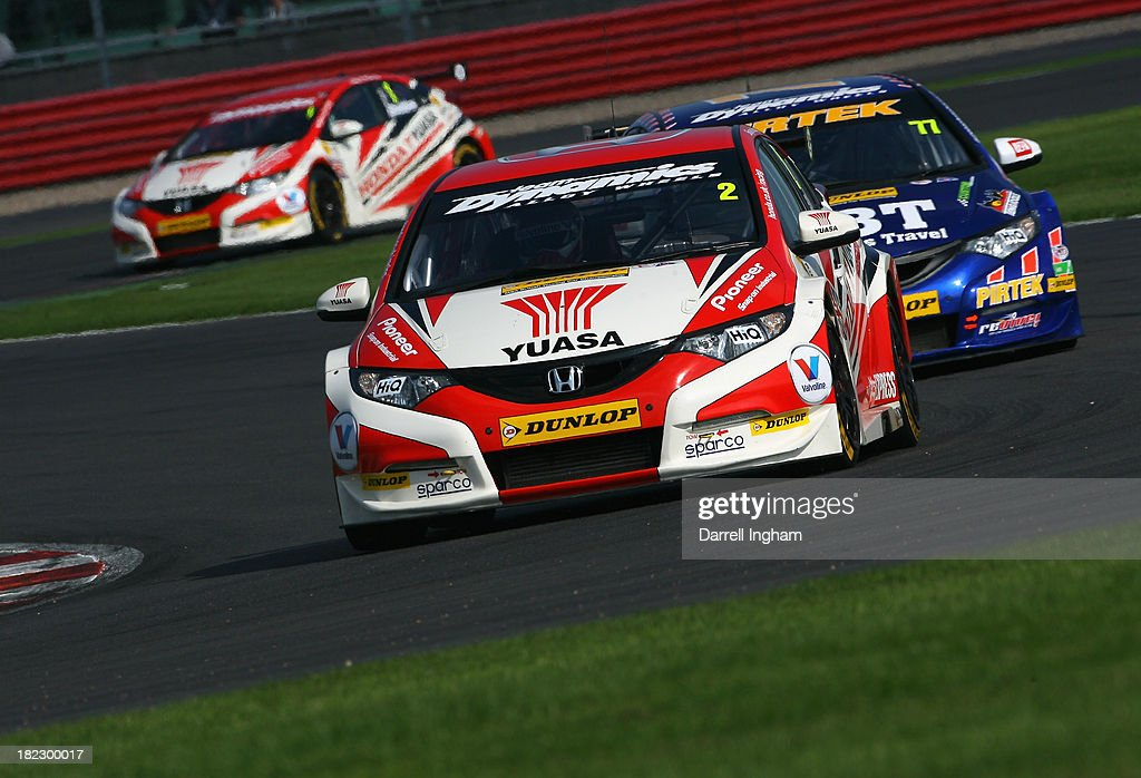 Matt Neal drives the #2 Honda Yuasa Racing Honda Civic ahead of Andrew Jordan #77 and team mate Gordon Shedden #1 during the Dunlop MSA British Touring Car Championship race at the Silverstone Circuit on September 29, 2013 in Towcester, United Kingdom.