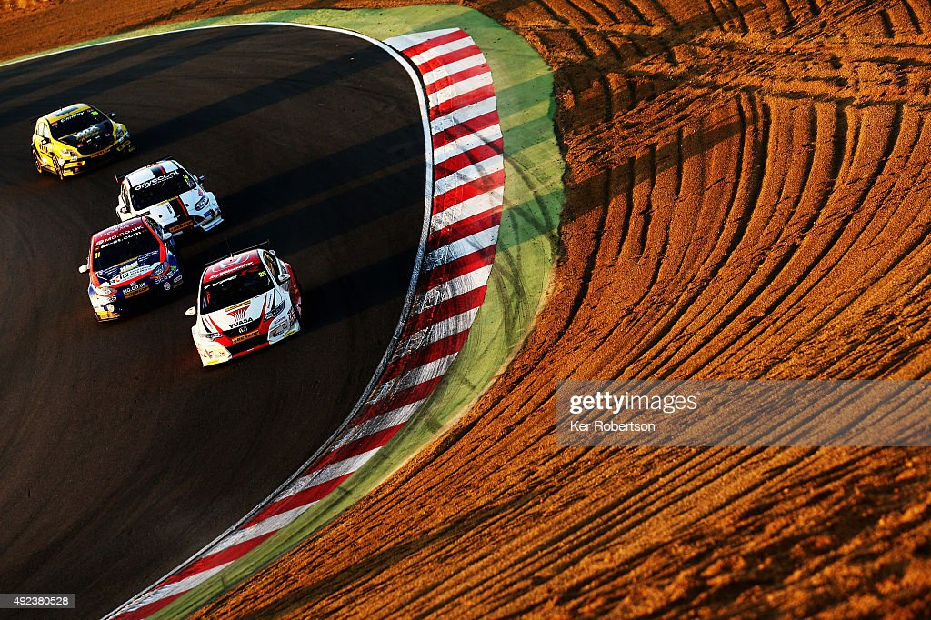 Matt Neal of Honda Racing heads a pack of cars down Paddock Hill during Race Three of the Final Round of the Dunlop MSA British Touring Car Championship at Brands Hatch on October 11, 2015 in Longfield, England.