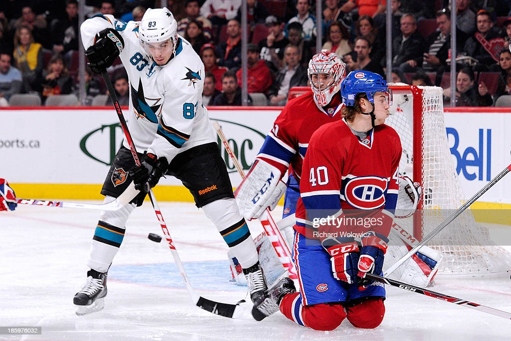<a gi-track='captionPersonalityLinkClicked' href=/galleries/search?phrase=Matt+Nieto&family=editorial&specificpeople=7895242 ng-click='$event.stopPropagation()'>Matt Nieto</a> #83 of the San Jose Sharks attempts to deflect the puck in front of <a gi-track='captionPersonalityLinkClicked' href=/galleries/search?phrase=Carey+Price&family=editorial&specificpeople=2222083 ng-click='$event.stopPropagation()'>Carey Price</a> #31 and <a gi-track='captionPersonalityLinkClicked' href=/galleries/search?phrase=Nathan+Beaulieu&family=editorial&specificpeople=6555395 ng-click='$event.stopPropagation()'>Nathan Beaulieu</a> #40 of the Montreal Canadiens during the NHL game at the Bell Centre on October 26, 2013 in Montreal, Quebec, Canada. The Sharks defeated the Canadiens 2-0.