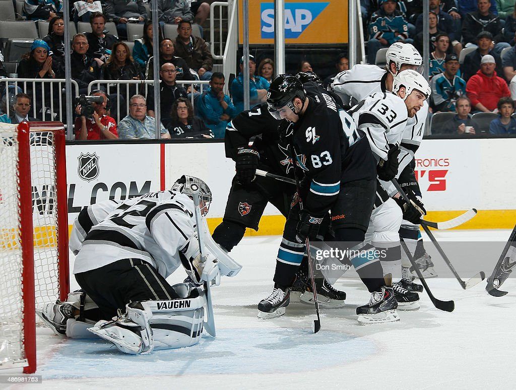 Matt Nieto #83 of the San Jose Sharks looks for a rebound against Jonathan Quick #32 and Willie Mitchell #33 of the Los Angeles Kings in Game Five of the First Round of the 2014 Stanley Cup Playoffs at SAP Center on April 26, 2014 in San Jose, California.