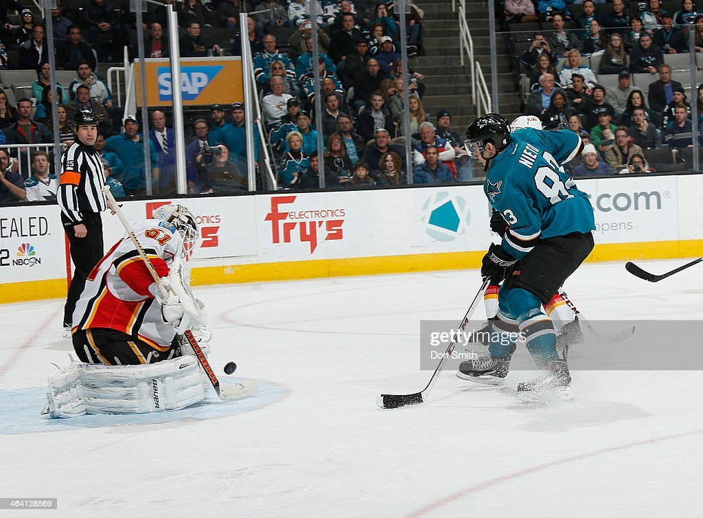 <a gi-track='captionPersonalityLinkClicked' href=/galleries/search?phrase=Matt+Nieto&family=editorial&specificpeople=7895242 ng-click='$event.stopPropagation()'>Matt Nieto</a> #83 of the San Jose Sharks tries to score against <a gi-track='captionPersonalityLinkClicked' href=/galleries/search?phrase=Karri+Ramo&family=editorial&specificpeople=716721 ng-click='$event.stopPropagation()'>Karri Ramo</a> #31 of the Calgary Flames during an NHL game on January 20, 2014 at SAP Center in San Jose, California.