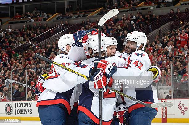 Matt Niskanen and Joel Ward of the Washington Capitals celebrate after Ward scored against the Chicago Blackhawks in the second period during the NHL...