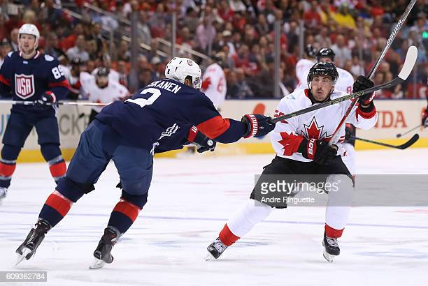 Matt Niskanen of Team USA battles for position with Brad Marchand of Team Canada during the World Cup of Hockey 2016 at Air Canada Centre on...
