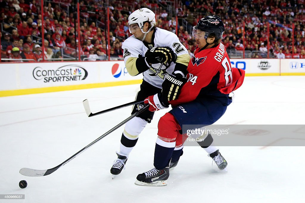 <a gi-track='captionPersonalityLinkClicked' href=/galleries/search?phrase=Matt+Niskanen&family=editorial&specificpeople=2106633 ng-click='$event.stopPropagation()'>Matt Niskanen</a> #2 of the Pittsburgh Penguins and <a gi-track='captionPersonalityLinkClicked' href=/galleries/search?phrase=Mikhail+Grabovski&family=editorial&specificpeople=2560547 ng-click='$event.stopPropagation()'>Mikhail Grabovski</a> #84 of the Washington Capitals go after the puck the second period at Verizon Center on November 20, 2013 in Washington, DC.