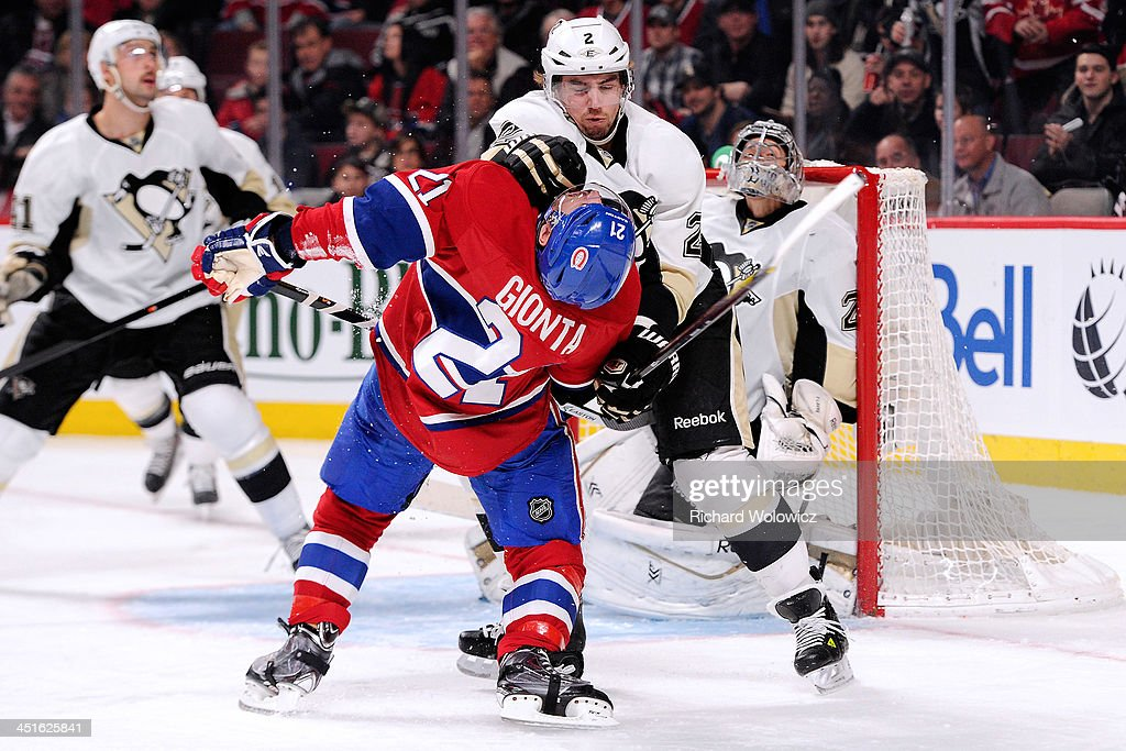 <a gi-track='captionPersonalityLinkClicked' href=/galleries/search?phrase=Matt+Niskanen&family=editorial&specificpeople=2106633 ng-click='$event.stopPropagation()'>Matt Niskanen</a> #2 of the Pittsburgh Penguins is called for roughing <a gi-track='captionPersonalityLinkClicked' href=/galleries/search?phrase=Brian+Gionta&family=editorial&specificpeople=202116 ng-click='$event.stopPropagation()'>Brian Gionta</a> #21 of the Montreal Canadiens during the NHL game at the Bell Centre on November 23, 2013 in Montreal, Quebec, Canada.