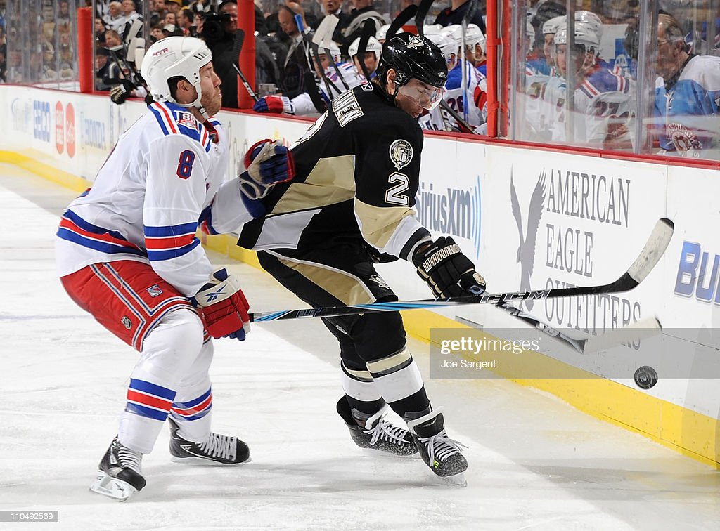 Matt Niskanen #2 of the Pittsburgh Penguins moves the puck in front of Brandon Prust #8 of the New York Rangers on March 20, 2011 at Consol Energy Center in Pittsburgh, Pennsylvania. New York won the game 5-2.