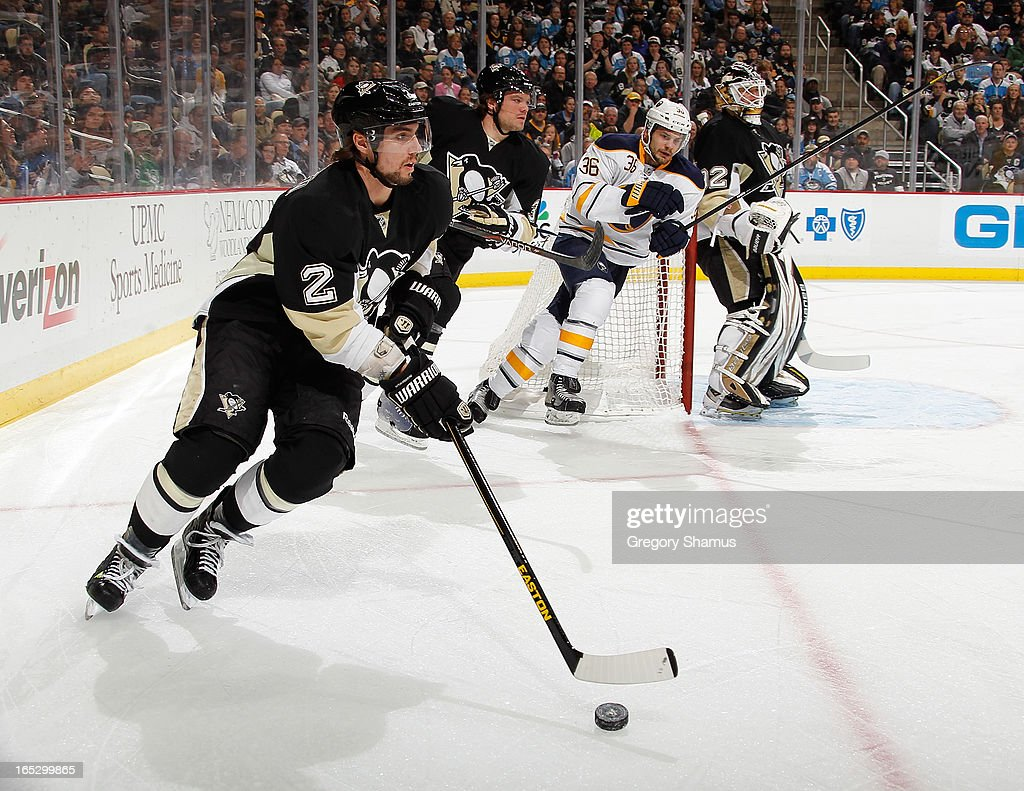 <a gi-track='captionPersonalityLinkClicked' href=/galleries/search?phrase=Matt+Niskanen&family=editorial&specificpeople=2106633 ng-click='$event.stopPropagation()'>Matt Niskanen</a> #2 of the Pittsburgh Penguins moves the puck up ice against the Buffalo Sabres on April 2, 2013 at Consol Energy Center in Pittsburgh, Pennsylvania.