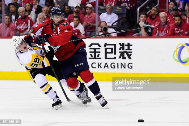 Matt Niskanen of the Washington Capitals and Jake Guentzel of the Pittsburgh Penguins battle for the puck in the second period in Game One of the...