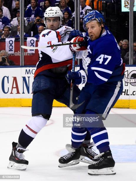 Matt Niskanen of the Washington Capitals and Leo Komarov of the Toronto Maple Leafs fight for position during the second period in Game Three of the...