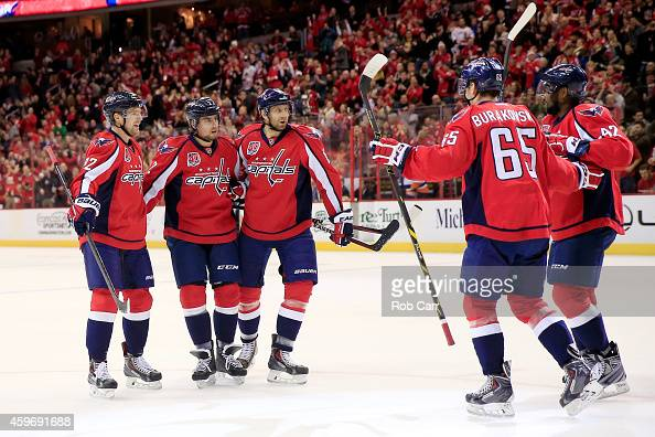 Matt Niskanen of the Washington Capitals celebrates his first period goal against the New York Islanders with teammates at Verizon Center on November...