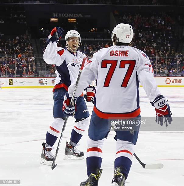 Matt Niskanen of the Washington Capitals celebrates his goal at 134 of the third period against the New York Islanders and is joined by TJ Oshie at...