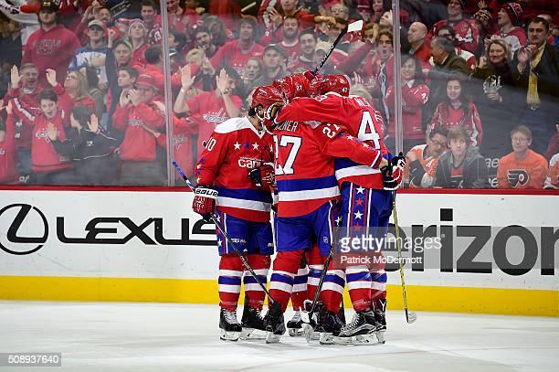 Matt Niskanen of the Washington Capitals celebrates his third period goal with his teammates during their game against the Philadelphia Flyers at...