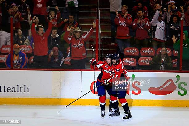Matt Niskanen of the Washington Capitals celebrates with Nicklas Backstrom after scoring a first period goal against the New York Islanders at...