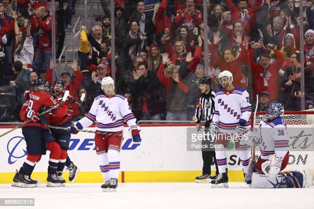 Matt Niskanen of the Washington Capitals celebrates with teammates after scoring a goal against the New York Rangers during the third period at...