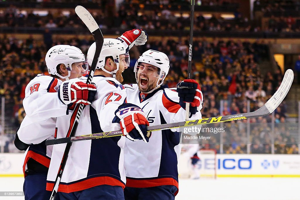 Matt Niskanen of the Washington Capitals congratulates Karl Alzner after he scored against the Boston Bruins during the second period at TD Garden on...