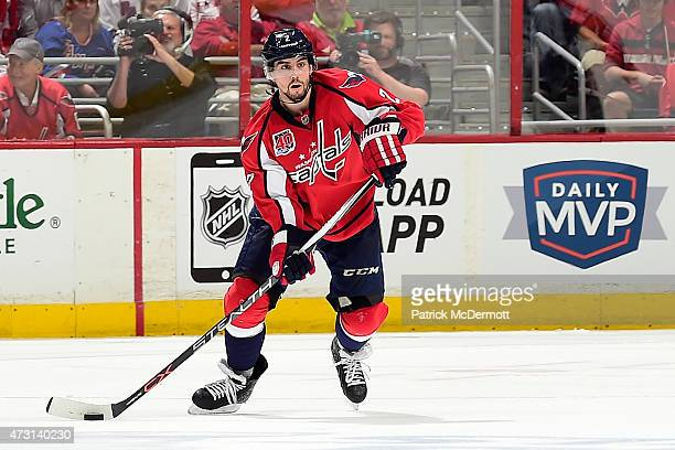 Matt Niskanen of the Washington Capitals controls the puck against the New York Rangers during the second period in Game Six of the Eastern...