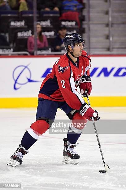 Matt Niskanen of the Washington Capitals controls the puck against the Carolina Hurricanes in the third period during an NHL game at Verizon Center...