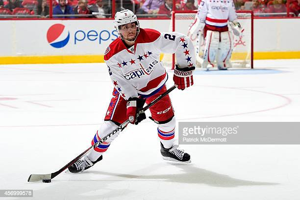 Matt Niskanen of the Washington Capitals controls the puck in the first period of game against the Montreal Canadiens in the Capitals season opener...
