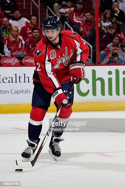 Matt Niskanen of the Washington Capitals controls the puck in the first period during an NHL Game against the Detroit Red Wings at Verizon Center on...