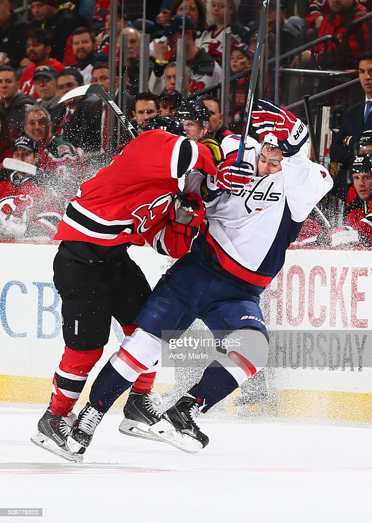 <a gi-track='captionPersonalityLinkClicked' href=/galleries/search?phrase=Matt+Niskanen&family=editorial&specificpeople=2106633 ng-click='$event.stopPropagation()'>Matt Niskanen</a> #2 of the Washington Capitals is checked by <a gi-track='captionPersonalityLinkClicked' href=/galleries/search?phrase=Stephen+Gionta&family=editorial&specificpeople=817969 ng-click='$event.stopPropagation()'>Stephen Gionta</a> #11 of the New Jersey Devils during the game at the Prudential Center on February 6, 2016 in Newark, New Jersey.