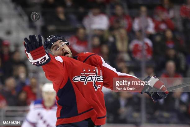 Matt Niskanen of the Washington Capitals pulls in a loose puck against the New York Rangers during the first period at Capital One Arena on December...