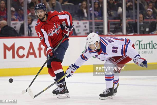Matt Niskanen of the Washington Capitals shoots the puck in front of Pavel Buchnevich of the New York Rangers during the second period at Capital One...