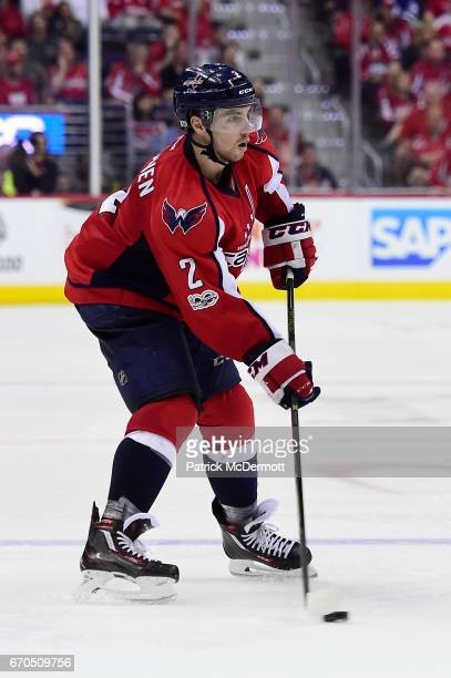 Matt Niskanen of the Washington Capitals skates with the puck against the Toronto Maple Leafs during double overtime in Game Two of the Eastern...