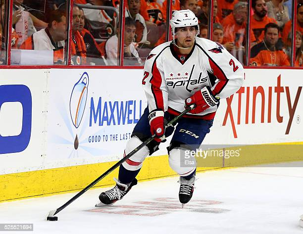 Matt Niskanen of the Washington Capitals takes the puck in the third period against the Philadelphia Flyers in Game Three of the Eastern Conference...