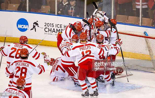 Matt O'Connor of the Boston University Terriers celebrates a Terrier victory against the Minnesota Duluth Bulldogs with teammates Matt Grzelcyk and...