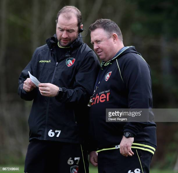 Matt O'Connor the Leicester Tigers head coach consults the notes with assistant coach Geordan Murphy during the Leicester Tigers training session...