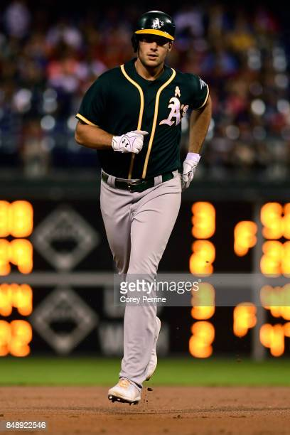 Matt Olson of the Oakland Athletics makes his way around the bases after hitting a homer during the second inning against the Philadelphia Phillies...