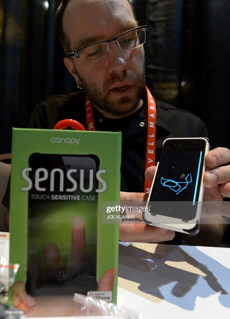 Matt Pacyga of Canopy shows Sensus touch sensitive case for iPhone during the opening event ''CES Unveiled'' during the International Consumer Electronics Show (CES) in Mandalay Bay Hotel resort on January 06, 2013 in Las Vegas, Nevada.